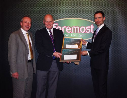 Ken Graham collects Titleist's awards from Chris Steel, The Foremost Chairman, and Andrew Cotter