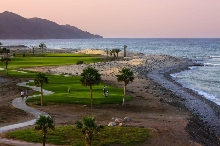 The golf course in Jebel Sifah is seamlessly integrated into the spectacular scenery and natural landscapes