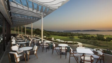 Costa Navarino Bay Course clubhouse at sunset