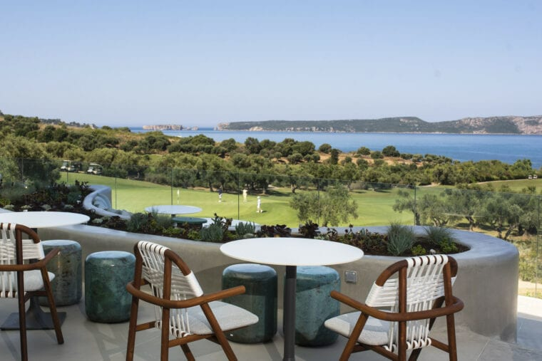 Costa Navarino Bay Course clubhouse balcony with a view on the golf course and the sea