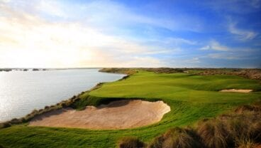 The 8th hole at Yas Links, showcasing its imposing hazards