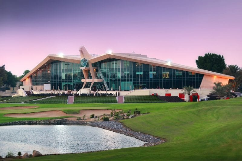 View of the iconic Falcon Clubhouse at Abu Dhabi Golf Club from 9th hole golf club management