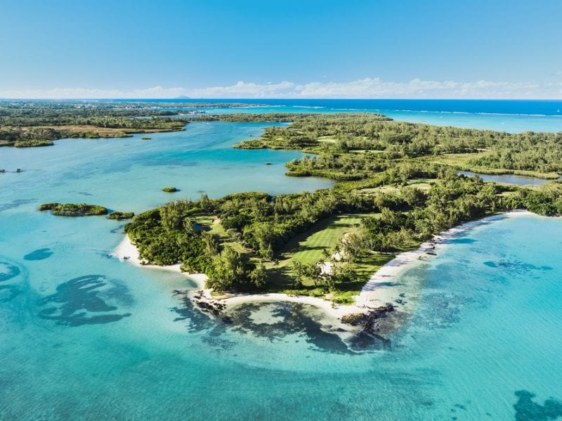 Ile aux Cerfs Golf Club and the very blue ocean and the island Mauritius