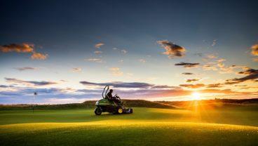 John Deere golf course mower in action